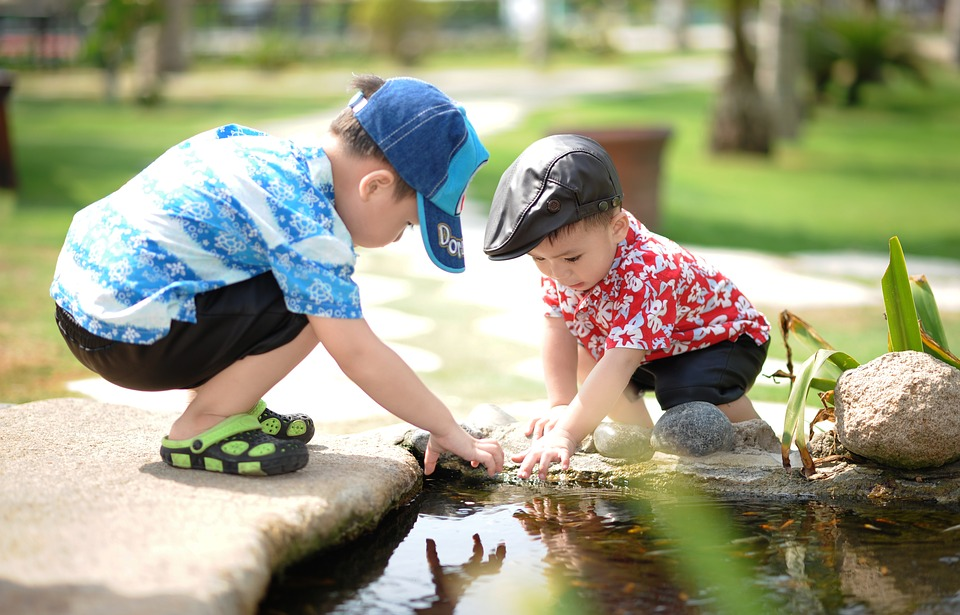 children enjoying a garden water feature